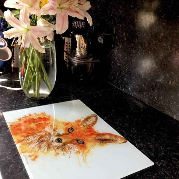 fox glass worktop saver by vase of lilies