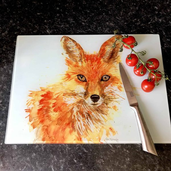 knife next to cherry tomatoes on fox worktop saver