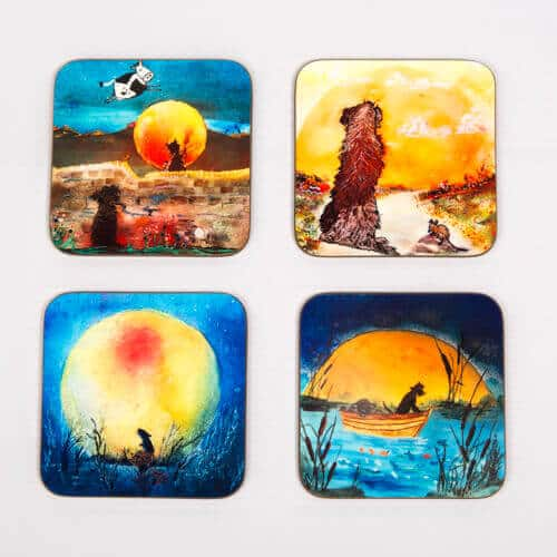 blue yellow illustrations on coasters of mice and dogs