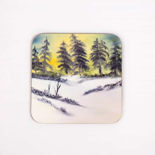 forest scene with snow on coaster