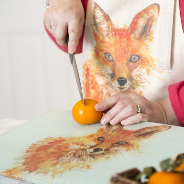 fox worktop saver with woman cutting orange with knife