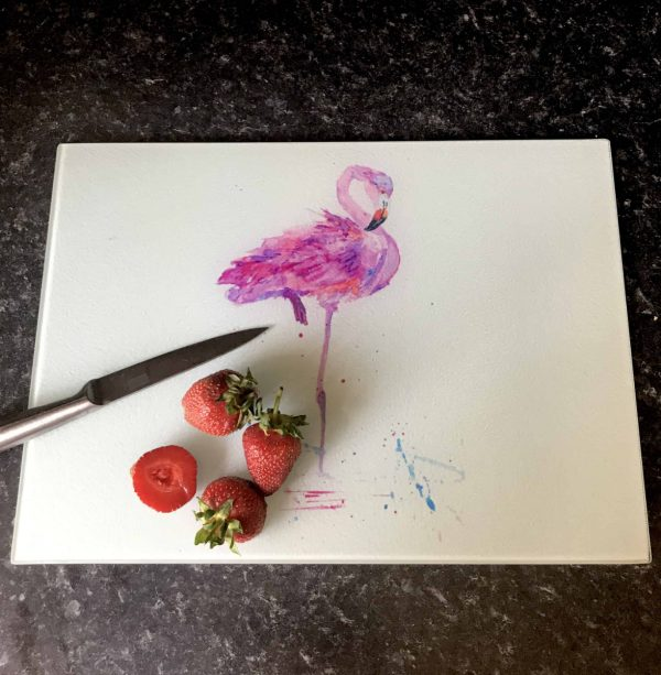 pink flamingo glass chopping board with strawberries