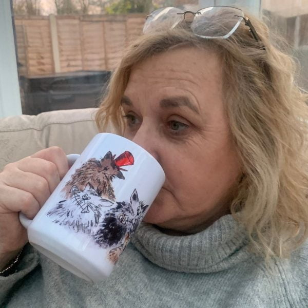 woman drinking from a cat mug
