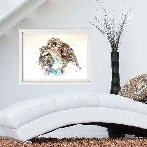 owl painting next to white chair