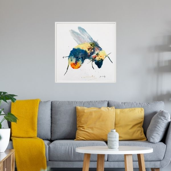 bee print with mustard blanket on grey chair
